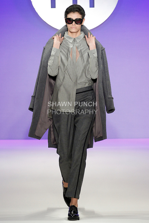 Model walks runway in an outfit by Rebecca Homen, during the FIT Future of Fashion 2014 Graduates' Collection fashion show, at the Fashion Institute of Technology on May 1, 2014.