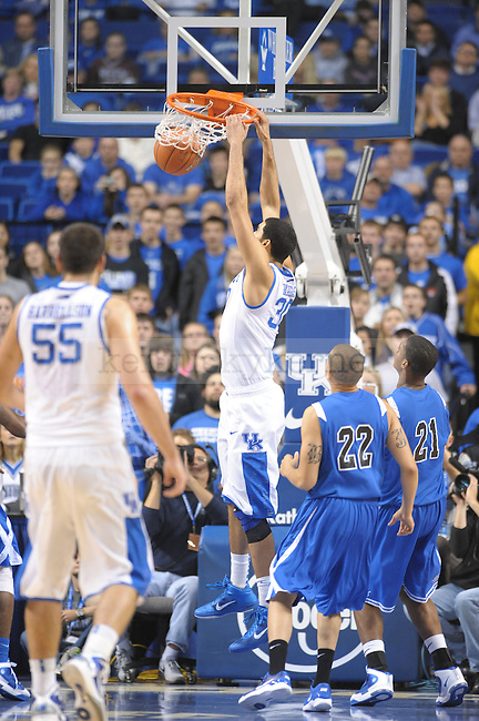 Junior Eloy Vargas dunks the ball during the UK mens basketball Dillard exhibition game. Photo by Mike Weaver | Staff