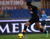 Calcio, semifinale di andata di Coppa Italia: Roma vs Napoli. Roma, stadio Olimpico, 5 febbraio 2014.<br /> AS Roma forward Gervinho, of Ivory Coast, scores during the Italian Cup first leg semifinal football match between AS Roma and Napoli at Rome's Olympic stadium, 5 February 2014. At bottom, Napoli goalkeeper Jose' Manuel Reina, of Spain, lies on the pitch.<br /> UPDATE IMAGES PRESS/Riccardo De Luca
