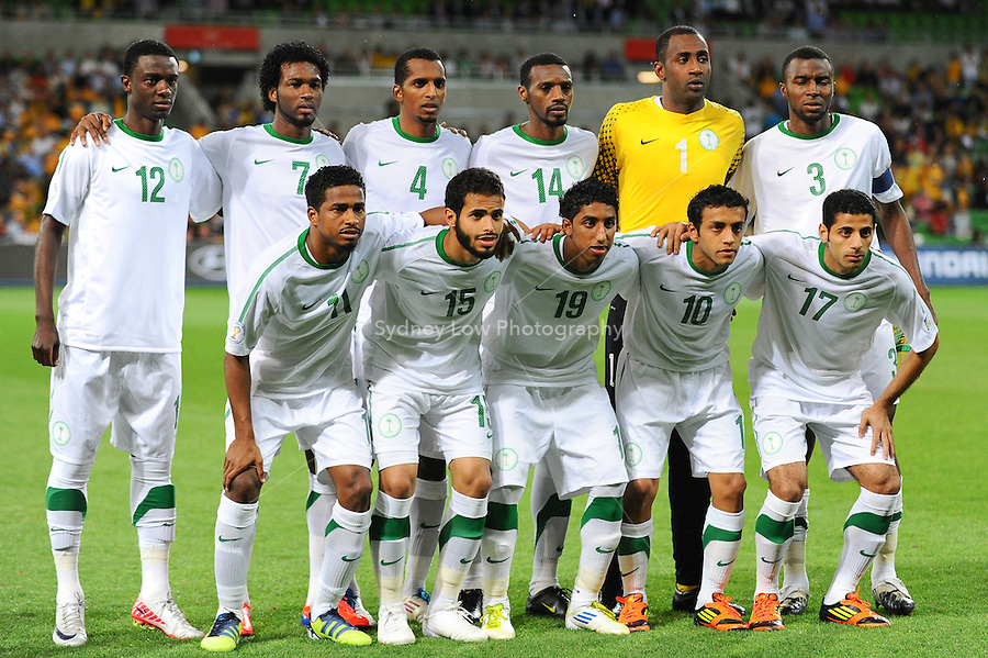 The Saudi Arabia team pose for a photo during the FIFA 2014 World Cup Group D Asian Qualifier match between Australia and Saudi Arabia at AAMI Park in Melbourne, Australia...This image is not for sale on this web site. Please contact Southcreek Global Media for licensing:.Toll Free: 1.800.934.5030.Canada: 701 Rossland Rd. East, Suite 315, Whitby, Ontario, Canada, L1N 9K3.USA: 10792 Baron Dr, Parma OH, USA 44130.Web: http://southcreekglobal.net/ and http://southcreekglobal.com/