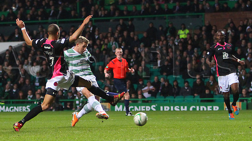 03.12.2014.  Glasgow, Scotland. Scottish Premier League.  Celtic versus Partick Thistle. Kris Commons shoots on goal