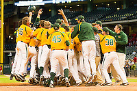 The Baylor Bears surround Max Muncy #9 (not pictured) after he hit a walk-off home run in the bottom of the 10th inning to defeat the Rice Owls 12-8 at Minute Maid Park on March 6, 2011 in Houston, Texas.  Photo by Brian Westerholt / Four Seam Images