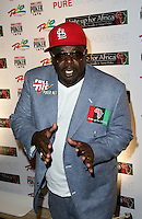 CEDRIC THE ENTERTAINER (Cedric Antonio Kyles).The Ante Up for Africa Celebrity Poker Tournament at the Rio Resort Hotel and Casino, Las Vegas, Nevada, USA..July 2nd, 2009.half length blue suit red baseball cap hat hands.CAP/ADM/MJT.© MJT/AdMedia/Capital Pictures