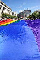 Protesters unfurled an enormous rainbow flag and took to the streets of Washington, DC, Sunday, Oct. 11, 2009, as part of the National Equality March. The march wound through the downtown district and National Mall before culminating at the Capitol Building lawn for a rally and speeches. Dozens of LGBT rights activists such as NAACP President Julian Bond, singer Lady Gaga, and activist Cleeve Jones called for full legal equality across the country, marking the 30th anniversary of the first such march, led by Harvey Milk in 1979. (Joseph Shemuel/pressphotointl.com)