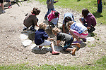 Children activities wattle and daub Iron Age celtic house Castell Henllys, Pembrokeshire, Wales