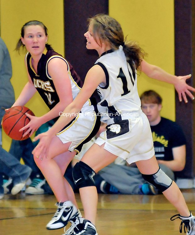 THOMASTON, CT-04 MARCH 2010-030410JS02-Thomaston's Hannah Martin(10) plays tight defense against Windsor Lock's Allison Pepin (11) during their Class S state tournament game Thursday at Thomaston High School. <br /> Jim Shannon Republican-American