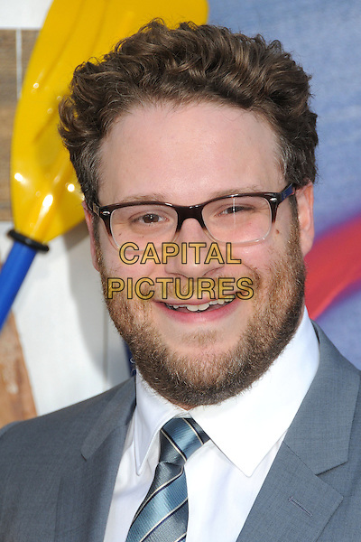 Seth Rogen<br /> 'This is the End' Los Angeles film premiere at the Regency Village Theatre, Westwood, California, USA.<br /> 3rd June 2013<br /> headshot portrait suit up white shirt blue beard glasses facial hair   <br /> CAP/ADM/BP<br /> &copy;Byron Purvis/AdMedia/Capital Pictures