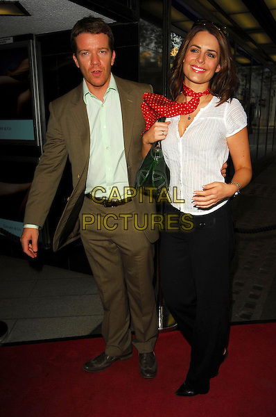 MAX BEESLEY & SUSIE AMY.Sketches Of Frank Gehry - private Tiffany & Co screening, Curzon Mayfair, London, UK..May 10th, 2006.Ref: CAN.full length black trousers white shirt brown suit polka dot neckerchief.www.capitalpictures.com.sales@capitalpictures.com.©Capital Pictures