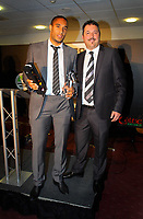 Pictured L-R: Ashley Williams receiving the Club Ambassador of the Year award by Ammcom manager. Thursday 10 May 2012<br /> Re: Swansea City FC awards dinner at the Liberty Stadium.
