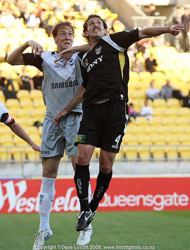 Michael Thwaite and Jon McKain rise to compete for a header during the A-League football match between Wellington Phoenix and Melbourne Victory at Westpac Stadium, Wellington, New Zealand on Friday, 28 November 2008. Photo: Dave Lintott / lintottphoto.co.nz