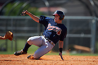 Atlanta Braves Luke Dykstra (18) slides into second during an instructional league game against the Houston Astros on October 1, 2015 at the Osceola County Complex in Kissimmee, Florida.  (Mike Janes/Four Seam Images)