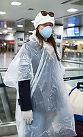 "New York, New York City. New Yorkers are told to stay home during the corona virus, (COVID-19) so New York has become eerily empty. Penn Station. ""My Mom made me dress like this,""says a passenger about to embark the Amtrak train back hme to Virgina at a nearly empty Penn Station."
