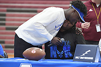 "NWA Democrat-Gazette/J.T. WAMPLER E'Kyious ""Chops"" Sanders hugs his mom Shenekia Sanders of Springdale Wednesday Feb. 6, 2019 during a signing day ceremony at Springdale High School. Sanders signed a letter of intent to play football for the Air Force."