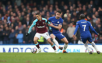 West Ham United's Javier Hernandez and Chelsea's Gary Cahill<br /> <br /> Photographer Rob Newell/CameraSport<br /> <br /> The Premier League - Chelsea v West Ham United - Sunday 8th April 2018 - Stamford Bridge - London<br /> <br /> World Copyright &copy; 2018 CameraSport. All rights reserved. 43 Linden Ave. Countesthorpe. Leicester. England. LE8 5PG - Tel: +44 (0) 116 277 4147 - admin@camerasport.com - www.camerasport.com