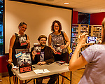 "July 26, 2017. Raleigh, North Carolina.<br /> <br /> Alan Gratz poses for a photo with (L to R) Karen Staman and Amy Kurtz Skelding. <br /> <br /> Author Alan Gratz spoke about and signed his new book ""Refugee"" at Quail Ridge Books. The young adult fiction novel contrasts the stories of three refugees from different time periods, a Jewish boy in 1930's Germany , a Cuban girl in 1994 and a Syrian boy in 2015."