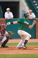 Chris Pelaez #22 of the Miami Hurricanes follows through on his swing against the Boston College Eagles at the 2010 ACC Baseball Tournament at NewBridge Bank Park May 27, 2010, in Greensboro, North Carolina.  The Eagles defeated the Hurricanes 12-10 in 10 innings.  Photo by Brian Westerholt / Four Seam Images