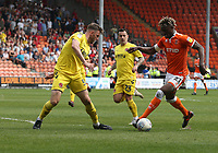 Fleetwood Town's Ashley Eastham keeps a watchful eye on Blackpool's Armand Gnanduillet<br /> <br /> Photographer Stephen White/CameraSport<br /> <br /> The EFL Sky Bet League One - Blackpool v Fleetwood Town - Monday 22nd April 2019 - Bloomfield Road - Blackpool<br /> <br /> World Copyright © 2019 CameraSport. All rights reserved. 43 Linden Ave. Countesthorpe. Leicester. England. LE8 5PG - Tel: +44 (0) 116 277 4147 - admin@camerasport.com - www.camerasport.com