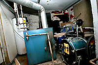 The furnace room of the White House serves as an equipment storage room during a punk concert in Woodstock, Illinois.  The White House was a small suburban residential home rented by a group of 20-somethings in Woodstock, Illinois, a distant northwestern suburb of Chicago.  For about a year, the renters of the house staged punk-rock concerts in the house's small basement, without the approval of the neighborhood, local government, or police.  .