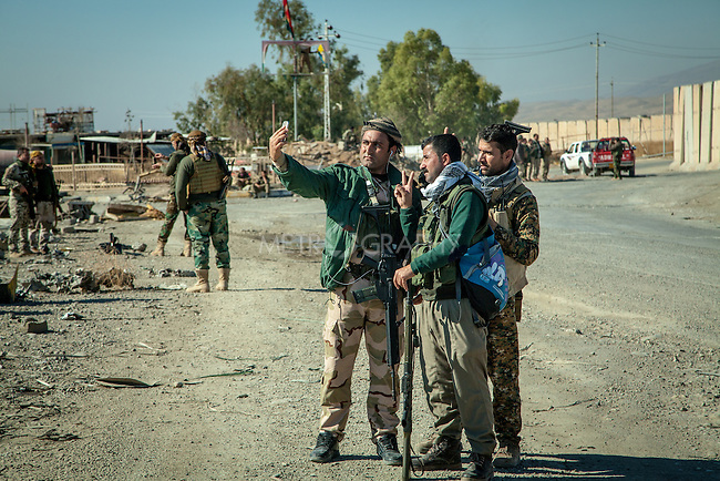 13/11/2015-- Iraq,Sinjar -- Peshmarga fighters taking selfie photos after Sinjar liberation, there were immediate transferring news from Sinjar into the social media networks.