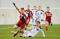 Colin Rolfe (9) of the Louisville Cardinals gets past the tackle of Jeb Brovsky (5) of the Notre Dame Fighting Irish. The Louisville Cardinals defeated the Notre Dame Fighting Irish 1-0 during the semi-finals of the Big East Men's Soccer Championship at Red Bull Arena in Harrison, NJ, on November 12, 2010.