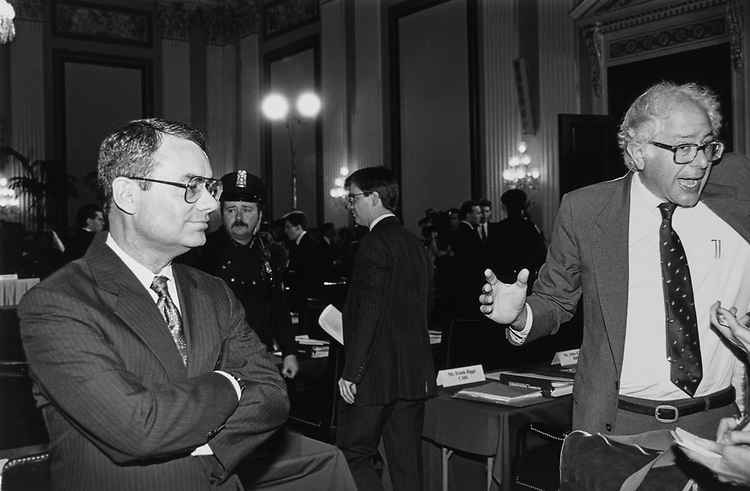 Rep.-elect Jim Bacchus, R-La., looks on calmly as Rep.- elect Bernie Sanders, I-Vt. talks animatedly with reporters before bipartisan orientation in Cannon Caucus room, on Nov. 29, 1990. (Photo by Maureen Keating/CQ Roll Call via Getty Images)