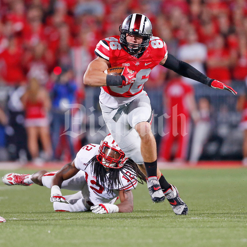 Ohio State Buckeyes tight end Jeff Heuerman (86) eludes Wisconsin Badgers safety Dezmen Southward (12) in second half action at Ohio Stadium on September 28, 2013.  (Chris Russell/Dispatch Photo)
