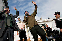 South America, Argentina, La Plata, Los Olmos. Freedom Behind Bars, Prison and Divinity - Inmates praise in the yard of Unit 25 of Los Olmos Prison. Los Olmos Prison is one of the principal security prisons in Argentina. Warden Svarez is pictured in the background. It hosts Unit 25, also known as Christ the Only Hope Prison Church, one of the largest prison churches worldwide. The transformation of criminals into the God fearing and leading them to the Lord has taken hold, not only in the lives of inmates, but also in inmate families and prison guards. Once the countries worst killers and thieves have since become spiritual leaders to other criminals, creating a revolutionary spiritual rehabilitation, July 2006 &copy; Stephen Blake Farrington<br />