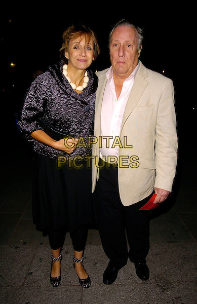 FREDERICK FORSYTH & PARTNER.The National Cafe Launch Party, National Gallery, London, UK..OCtober 26th, 2006.Ref: CAN.full length black skirt beige suit jacket trousers.www.capitalpictures.com.sales@capitalpictures.com.©Can Nguyen/Capital Pictures