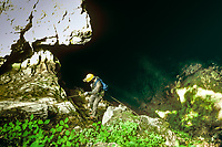 A caver prepares to descend into  the 95 foot deep Crookshank Pit entrance to the Friars Hole Cave System in West Virginia. Friars Hole Cave System, with more than 40 miles of passages is the largest in West Virginia and the sixth largest in the U.S.
