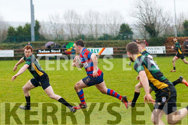 Willie Casey, Castleisland, bursts away from a ruck with Luke O'Brian trying to intercept when the sides met in Castlesland last Sunday in the Munster junior cup.