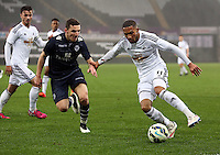 Pictured: Kenji Gorre of Swansea (R) Monday 30 March 2015<br />
