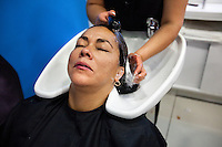 Angelica Alvarez, partner of Edison Pena, has her hair done before his rescue...Edison Pena was the 12th miner to be freed from the San Jose mine in Chile where 33 miners were trapped for 69 days. He was the first to return home from hospital.