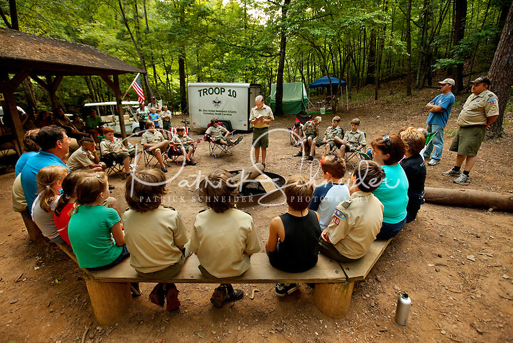 Boy Scouts attending Boy Scout resident camp at Camp Raven Knob in summer 2010 hold a ceremony during a visit from parents. Camp Raven Knob Scout Reservation, one of the largest Boy Scout camps in the United States, is located within Boy Scouts of America's Old Hickory Council in Mt. Airy, North Carolina. Troops from across the US attend the camp's one-week residential boys' summer programs, which offer instruction on more than 40 merit badges, adventure programs and new Scout orientation.