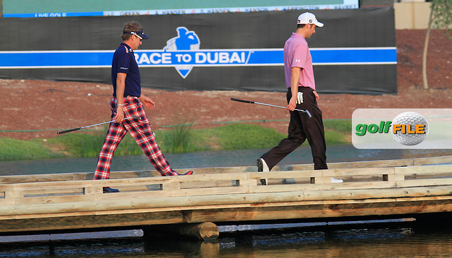 Ross Fisher and Ian Poulter cross the footbridge to the 17th green during Day 3 of the Dubai World Championship, Earth Course, Jumeirah Golf Estates, Dubai, 27th November 2010..(Picture Eoin Clarke/www.golffile.ie)
