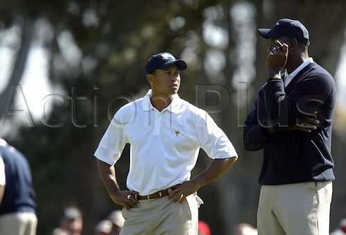6th October 2009:  Tiger Woods chats with Michael Jordan as he waits to take his second shot on hole No. 7 during a practice round for the Presidents Cup at Harding Park golf course, in San Francisco, California, on Tuesday.  (Photo by Anda Chu/ActionPlus). UK Licenses Only