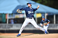 Asheville Tourists starting pitcher Nick Bush (29) delivers a pitch during a game against the Rome Braves at McCormick Field on July 20, 2019 in Asheville, North Carolina. The Tourists defeated the Braves 3-2. (Tony Farlow/Four Seam Images)