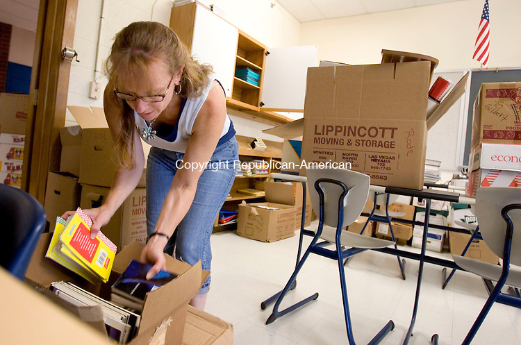 WINSTED, CT. 23 August 2011-082311SV05--Tamra Weeks, special education teacher, looks through a box of books while getting her classroom ready for students at The Gilbert School in Winsted Tuesday.<br /> Steven Valenti Republican-American