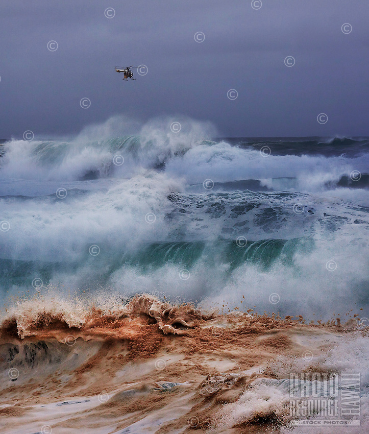A Honolulu Fire Department helicopter hovers over the Banzai Pipeline off of Ehukai Beach Parkon the North Shore of O'ahu.