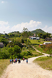 BELIZE, Punta Gorda, Toledo District, children in the Maya village of San Jose head home after school