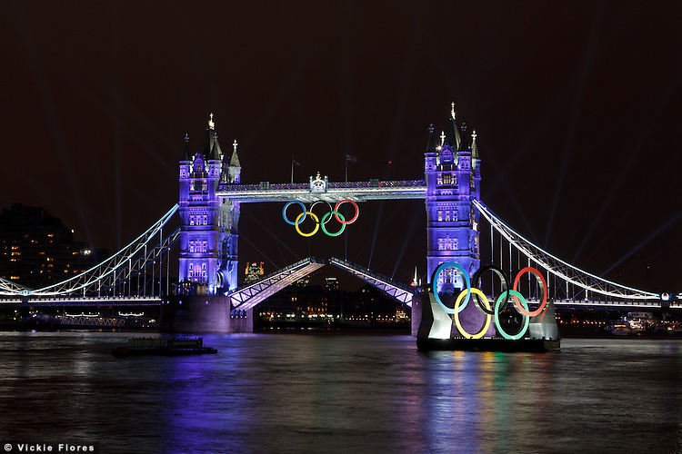 Coloured lights illuminate Tower Bridge as the bascules are raised during the opening ceremony of the London 2012 Olympic Games - 27 July 2012