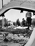 First Responders working at the crash site of Eastern Flight 66, between Rockaway Tpke and JFK Airport on June 24, 1975.         Photo by Jim m Peppler. Copyright Jim Peppler/1975.
