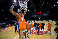 Sharks captain Ruben Te Rangi snips the net after the national basketball league final  between Wellington Saints and Southland Sharks at TSB Bank Arena in Wellington, New Zealand on Sunday, 5 August 2018. Photo: Dave Lintott / lintottphoto.co.nz
