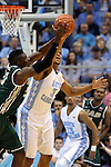27 December 2014: North Carolina's Kennedy Meeks (3) knocks the ball away from UAB's Tosin Mehinti (21). The University of North Carolina Tar Heels played the University of Alabama Birmingham Blazers in an NCAA Division I Men's basketball game at the Dean E. Smith Center in Chapel Hill, North Carolina. UNC won the game 89-58.