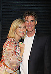 Grammy Award Winning Olivia Newton-John poses with her husband John Easterling after the performance of Victoria E. Calderon's play Manipulation on June 24, 2011 at the Cherry Lane Theatre, New York City, New York. (Photo by Sue Coflin/Max Photos)
