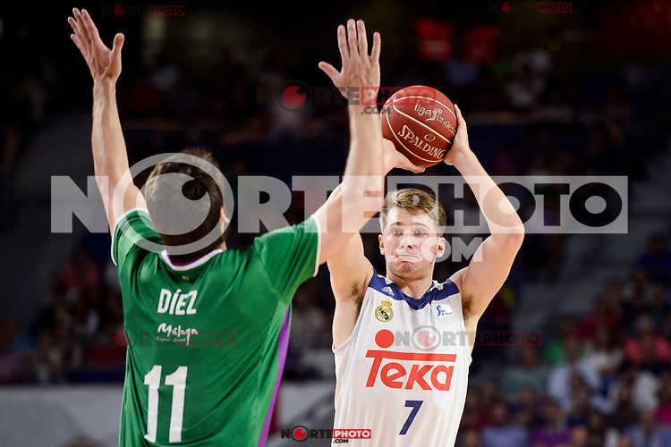 Real Madrid's Luka Doncic and Unicaja Malaga's Dani Diez during semi finals of playoff Liga Endesa match between Real Madrid and Unicaja Malaga at Wizink Center in Madrid, June 02, 2017. Spain.<br /> (ALTERPHOTOS/BorjaB.Hojas) /NortePhoto.com