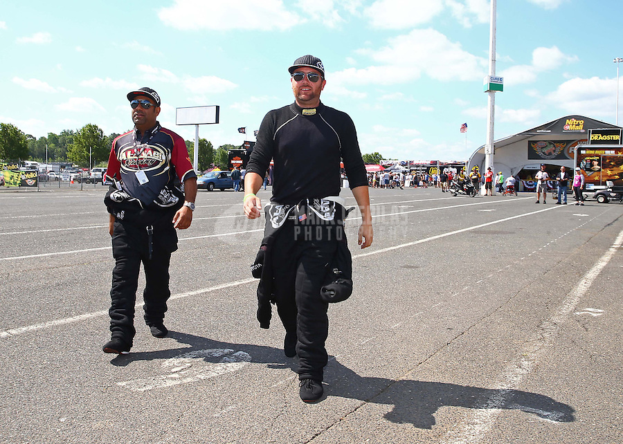 Jun. 2, 2013; Englishtown, NJ, USA: NHRA top fuel dragster driver Khalid Albalooshi (left) with teammate Shawn Langdon during the Summer Nationals at Raceway Park. Mandatory Credit: Mark J. Rebilas-
