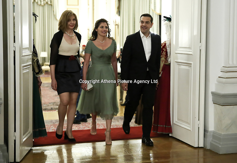 Pictured L-R: Prime Minister Alexis Tsipras (R) arrives with wife Betty (Peristera) Baziana (C) during the official state dinner at the Presidential Mansion in Athens, Greece. Wednesday 09 May 2018 <br /> Re: Official visit of HRH Prnce Charles and his wife the Duchess of Cornwall to Athens, Greece.