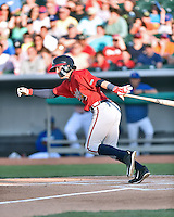 Mississippi Braves shortstop Dansby Swanson (5) swings at a pitch during a game against the Tennessee Smokies at Smokies Stadium on May 7, 2016 in Kodak, Tennessee. The Smokies defeated the Braves 5-3. (Tony Farlow/Four Seam Images)