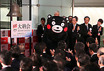 December 30, 2016, Tokyo, Japan - Kumamoto prefecture's bear character Kumamon rings a bell with a wooden hammer during a ceremony to celebrate the last trading day of 2016 at the Tokyo Stock Exchange on Friday, December 30, 2016. Japan's share prices fell 30.77 yen to close at 19,114.37 yen at the Tokto Stock Exchange, but finished the highest close in 20 years for the last day trading of the year.  (Photo by Yoshio Tsunoda/AFLO) LWX -ytd-