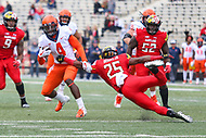 College Park, MD - October 27, 2018: Illinois Fighting Illini wide receiver Ricky Smalling (4) avoids Maryland Terrapins defensive back Antoine Brooks Jr. (25) tackle during the game between Illinois and Maryland at  Capital One Field at Maryland Stadium in College Park, MD.  (Photo by Elliott Brown/Media Images International)
